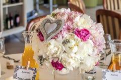 Mediterranean interior - flowers. Mediterranean interior - pastel flower bunch on a table Stock Photo