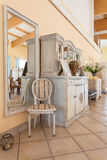 Mediterranean interior - mirror and chair Royalty Free Stock Images