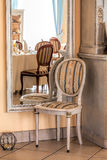 Mediterranean interior - mirror and chair Stock Image