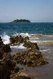 Mediterranean island and breakers Stock Photo