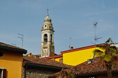 Historic bell tower of Italian village stock photos