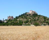 Mediterranean landscape. Farmland and a castle on a mountain Stock Photo