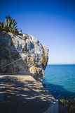 Mediterranean landscape with cliffs and blue sea background Royalty Free Stock Images