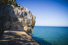 Mediterranean landscape with cliffs and blue sea background Stock Photos