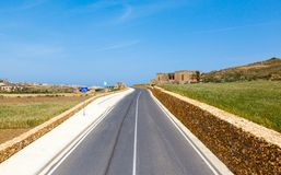 Mediterranean landscape. road, rail fence Stock Photos
