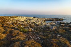 Landscape with rough rocks and ocean stock photo
