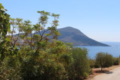 Mediterranean Landscape. A scenic view across a bay in a Mediterranean climate including the sea, hills in the distance and olive trees and other generic Royalty Free Stock Photography