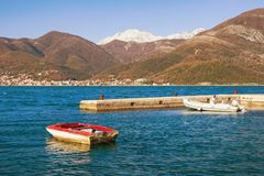 Mediterranean landscape on sunny winter day. Montenegro, Bay of Kotor. View of snow-capped mountain of Orjen royalty free stock photos