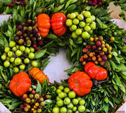 Mediterranean laurel wreath of spices and fruits. Mediterranean laurel wreath with green olives and red tomatoes Royalty Free Stock Image