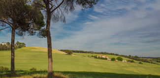 Mediterranean meadow and houses agriculture Stock Photography