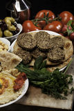 Mediterranean Meal with Falafels. Mediterranean  meal of falafels with humus, olives,  chickpeas, radishes and tomatoes Royalty Free Stock Photos
