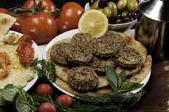 Mediterranean Meal with Falafels. Mediterranean  meal of falafels with humus, olives,  chickpeas, radishes and tomatoes Stock Images