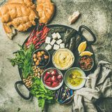 Mediterranean meze starter platter. Mediterranean or Middle Eastern meze starters fingerfood platter. Flat-lay of stuffed pickled paprikas, cheese, dolma, hummus stock images