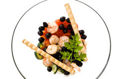 Mediterranean Mix. Food & Drinks - Mediterranean Recipes - Shrimps salad with black olives, cherry tomatoes, cucumber and breadsticks. Isolated on white Stock Photos