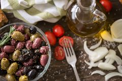 Mediterranean mix of olives for salad in oil. With spices Royalty Free Stock Photo