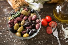 Mediterranean mix of olives for salad in oil top view. Mediterranean mix of olives for salad in oil with spices top view Stock Image