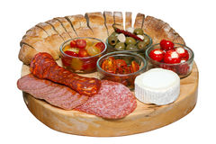 Mediterranean Mixed Antipasti on a Wooden Board. Mediterranean assorted antipasti on a wooden board with an isolated white background and clipping path Royalty Free Stock Photography