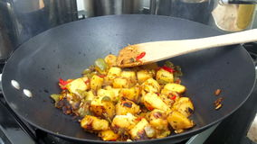 Mediterranean mixed vegetables simmering in a wok stock video
