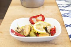 Mediterranean mussels meat mezze on wood royalty free stock images