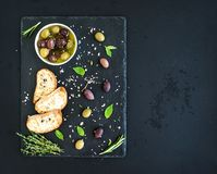 Mediterranean olives with herbs and ciabatta Stock Photography