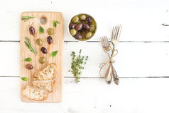 Mediterranean olives with herbs and ciabatta Royalty Free Stock Image