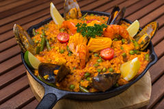 Mediterranean paella with seafood in frying pan Stock Photos