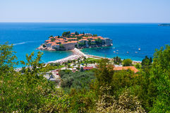 The mediterranean paradise. The former fishing village located on the stone islet became the luxury resort with cozy sand beaches and shady gardens, Sveti Stefan Royalty Free Stock Photos