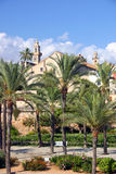 Mediterranean Park. In summer with palms, a way and some buildings in the background Stock Images