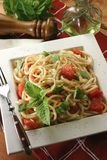 Mediterranean pasta. With fresh vegetables recipe, with fork, oil bottle and pepper grinder Stock Images
