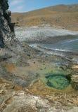 Mediterranean pebble beach and waterhole in Almeria, Spain Stock Photos