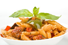 Mediterranean penne pasta. In a white bowl stock photography