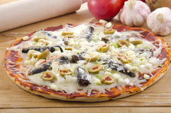 Mediterranean pizza with anchovies Stock Photos