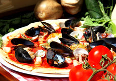 Mediterranean pizza with sea products and mussels Stock Photography