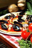Mediterranean pizza with sea products and mussels Stock Images