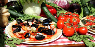 Mediterranean pizza with sea products and mussels Stock Image