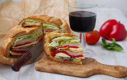 Mediterranean Pressed Picnic Sandwich with mozarella, grilled vegetables and ham. Spain Stock Images