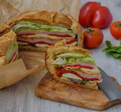 Mediterranean Pressed Picnic Sandwich with mozarella, grilled vegetables and ham. Spain Royalty Free Stock Photo