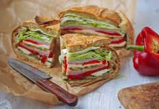 Mediterranean Pressed Picnic Sandwich with mozarella, grilled vegetables and ham. Spain Stock Photo