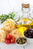 Mediterranean products. Pasta, tomatoes and capers Royalty Free Stock Images