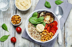 Mediterranean quinoa hummus bowl with eggplants, tomatoes and sp. Inach. toning. selective focus Stock Photo