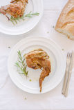 Mediterranean recipe. Traditional baked rabbit with rosemary Royalty Free Stock Images