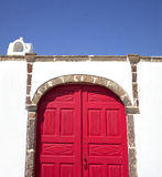 Mediterranean red doors. Wooden red doors closeup in greece Royalty Free Stock Image