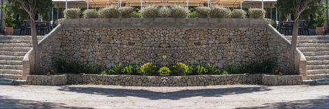 Mediterranean Retaining wall made of natural stones. Mediterranean retaining wall of traditional natural stone for a terrace of a restaurant Royalty Free Stock Photos