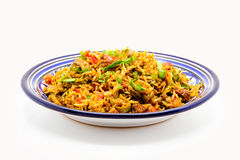 Mediterranean Rice. Served in a blue plate Stock Photography
