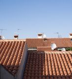 Mediterranean rooftops. With red tiles against clear blue sky Stock Photo