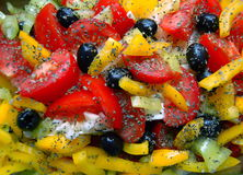 Mediterranean Salad. Closeup on fresh Mediterranean salad with black olives, tomatoes,paprika and feta cheese Royalty Free Stock Photos