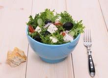 Mediterranean salad, big black olives, sheeps cheese. Close up Stock Photo