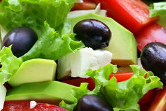 Mediterranean salad with black olives, lettuce, cheese Royalty Free Stock Images