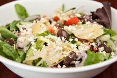 Mediterranean Salad. A classic Mediterranean salad made of mixed greens, tomato, cucumber, artichoke hearts, feta cheese, kalamata olives and balsamic dressing Stock Photos