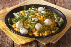 Mediterranean salad of corn, mozzarella cheese and arugula close Stock Image
